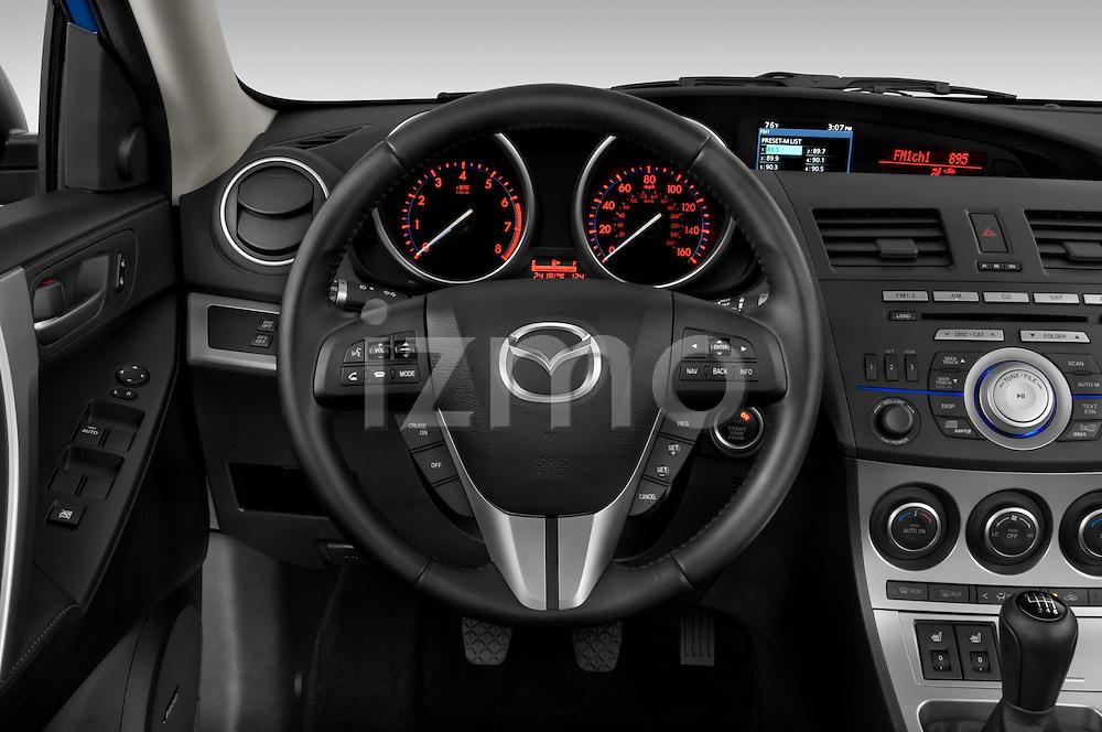 Steering wheel view of a 2010 Mazda 3 5-Door S Grand Touring