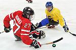 Brad Bowden, Vancouver 2010 - Para Ice Hockey // Para-hockey sure glace.<br /> Team Canada plays against Sweden in Para Ice Hockey action // Équipe Canada joue contre la Suède dans un match de para-hockey sur glace. 14/03/2010.