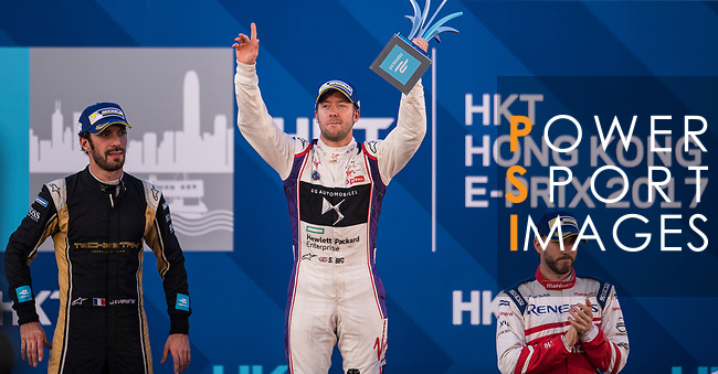 Sam Bird of Great Britain from DS Virgin Racing celebrates with trophy at the podium after winning the FIA Formula E Hong Kong E-Prix Round 1 at the Central Harbourfront Circuit on 02 December 2017 in Hong Kong, Hong Kong. Photo by Marcio Rodrigo Machado / Power Sport Images