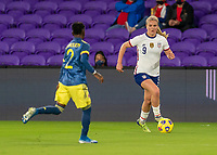 ORLANDO, FL - JANUARY 18: Lindsey Horan #9 of the USWNT dribbles during a game between Colombia and USWNT at Exploria Stadium on January 18, 2021 in Orlando, Florida.
