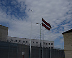 Latvian flag floats in front of the Cesu correctional institution of juveniles which has been renovated in one part and newly built in other part, Cesu, May 2013. <br /> <br /> There are 50 inmates at the moment at the correctional institution.