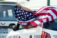 USA fans wave American flags while taking a group of taxis to watch the United States play Guatemala at Estadio Mateo Flores in Guatemala City, Guatemala in a World Cup Qualifier on Tue. June 12, 2012.