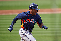 Houston Astros Pedro Leon (98) runs to first base during a Major League Spring Training game against the Miami Marlins on March 21, 2021 at Roger Dean Stadium in Jupiter, Florida.  (Mike Janes/Four Seam Images)