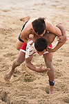 Wrestlers compete during the Beach Wrestling Men's competition between Thailand and Philippines on Day Eight of the 5th Asian Beach Games 2016 at Bien Dong Park on 01 October 2016, in Danang, Vietnam. Photo by Marcio Machado / Power Sport Images