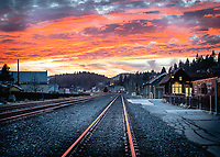 A remarkable sunset over the Sierra west of Truckee with the Union Pacific tracks and Downtown Truckee in the foreground.