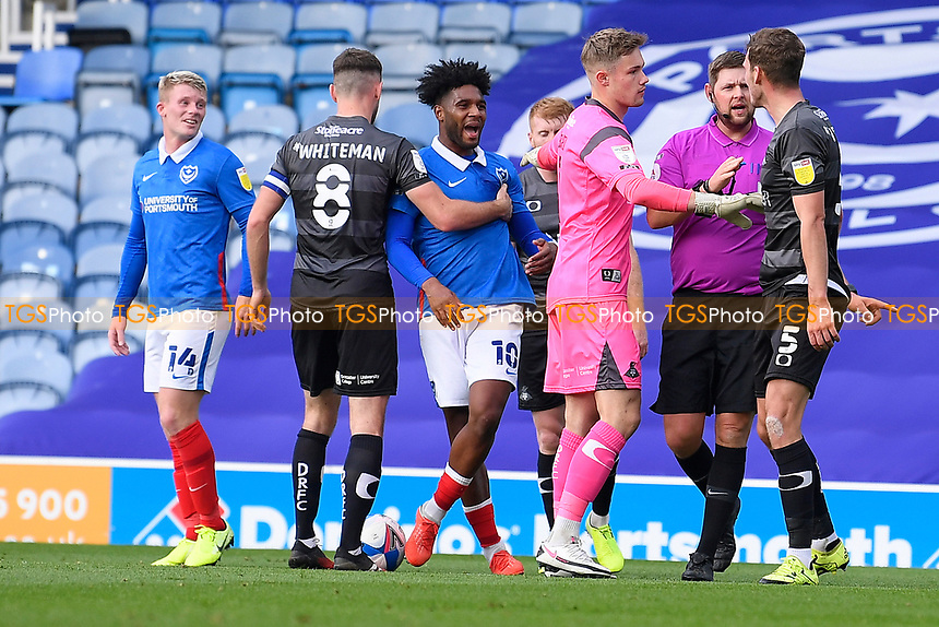 Ellis Harrison of Portsmouth middle has words with Joe Wright of Doncaster Rovers right during Portsmouth vs Doncaster Rovers, Sky Bet EFL League 1 Football at Fratton Park on 17th October 2020