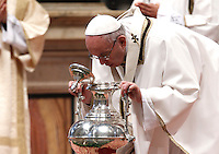 Papa Francesco celebra la Messa del Crisma in occasione del Giovedi' Santo, nella Basilica di San Pietro, Citta' del Vaticano, 24 marzo 2016.<br /> Pope Francis blows inside an amphora containing holy oil during the Holy Thursday Chrism mass in St. Peter's Basilica at the Vatican, 24 March 2016.<br /> UPDATE IMAGES PRESS/Isabella Bonotto<br /> <br /> STRICTLY ONLY FOR EDITORIAL USE