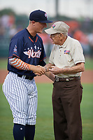 Tampa Yankees pitcher Andrew Schwaab (34) hands the ceremonial first pitch ball to an Honor Flight Veteran after throwing out a ceremonial first pitch before the Florida State League All-Star Game on June 17, 2017 at Joker Marchant Stadium in Lakeland, Florida.  FSL North All-Stars defeated the FSL South All-Stars  5-2.  (Mike Janes/Four Seam Images)