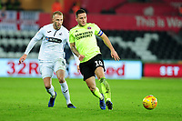 Mike van der Hoorn of Swansea City battles with Billy Sharp of Sheffield United during the Sky Bet Championship match between Swansea City and Sheffield United at the Liberty Stadium in Swansea, Wales, UK. Saturday 19 January 2019
