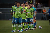 SAN JOSE, CA - MAY 12: Seattle Sounders players line up for the National Anthem before a game between San Jose Earthquakes and Seattle Sounders FC at PayPal Park on May 12, 2021 in San Jose, California.