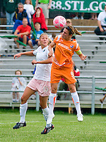 Sky Blue FC midfielder/forward Heather O'Reilly (9) goes up for a ball against St. Louis Athletica midfielder Amanda Cinalli (15) during a WPS match at Anheuser-Busch Soccer Park, in St. Louis, MO, June 7 2009.  Athletica won the match 1-0.