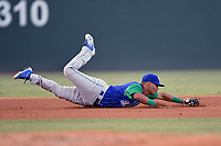 Third baseman Carlos Diaz (14) of the Lexington Legends lunges for a ground ball during a game against the Greenville Drive on Saturday, September 1, 2018, at Fluor Field at the West End in Greenville, South Carolina. Greenville won, 9-6. (Tom Priddy/Four Seam Images)