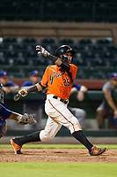 AZL Giants center fielder Ismael Munguia (29) follows through on his swing against the AZL Rangers on September 4, 2017 at Scottsdale Stadium in Scottsdale, Arizona. AZL Giants defeated the AZL Rangers 6-5 to advance to the Arizona League Championship Series. (Zachary Lucy/Four Seam Images)