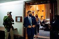 """United States Senator Mitt Romney (Republican of Utah), makes his exit following a US Senate Homeland Security and Governmental Affairs business meeting to consider a motion to authorize the Chairman to issue notices for taking depositions, subpoenas for records, and subpoenas for testimony, to individuals relating to the Federal Bureau of Investigation's Crossfire Hurricane Investigation; the DOJ Inspector General's review of that investigation; and the """"unmasking"""" of U.S. persons affiliated with the Trump campaign, transition team, and Trump administration, as described in Schedule A (Items 1-3), and the nominations of John Gibbs, of Michigan, to be Director of the Office of Personnel Management, and John M. Barger, of California, Christopher Bancroft Burnham, of Connecticut, and Frank Dunlevy, of California, each to be a Member of the Federal Retirement Thrift Investment Board.in the Dirksen Senate Office Building on Capitol Hill in Washington, DC., Wednesday, September 16, 2020. <br /> Credit: Rod Lamkey / CNP /MediaPunch"""