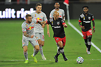 WASHINGTON, DC - SEPTEMBER 12: Federico Higuain #2 of D.C. United battles for the ball with Daniel Royer #77 and Aaron Long #33 of New York Red Bulls during a game between New York Red Bulls and D.C. United at Audi Field on September 12, 2020 in Washington, DC.
