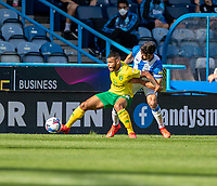 12th September 2020 The John Smiths Stadium, Huddersfield, Yorkshire, England; English Championship Football, Huddersfield Town versus Norwich City;  Timm Klose of Norwich City under pressure from   Christopher Schindler (C) of Huddersfield Town