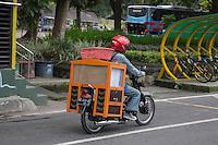 Yogyakarta, Java, Indonesia.  Carrying Goods on a Motorbike.
