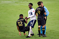 LOS ANGELES, CA - SEPTEMBER 23: Janio Bikel #19 of the Vancouver Whitecaps helps up Diego Palacios #12 of LAFC during a game between Vancouver Whitecaps and Los Angeles FC at Banc of California Stadium on September 23, 2020 in Los Angeles, California.
