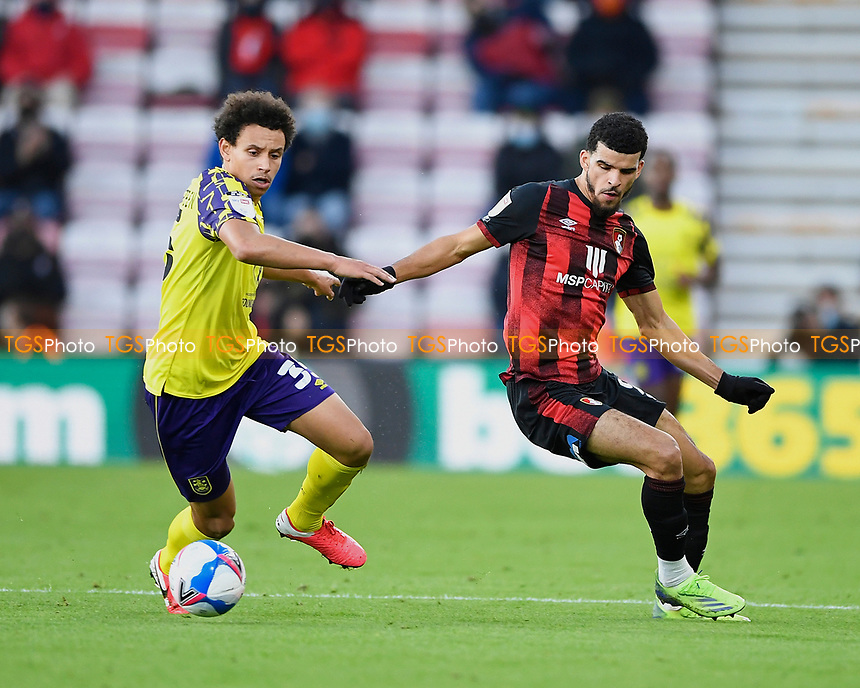 Rarmani Edmonds-Green of Huddersfield Town and Dominic Solanke of AFC Bournemouth vie for the ball during AFC Bournemouth vs Huddersfield Town, Sky Bet EFL Championship Football at the Vitality Stadium on 12th December 2020