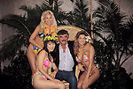 Burt Reynolds with the Hawian Tropic Girls<br /> Attending the V.S.D.A.  Video Software Convention on May 23, 1995 in Dallas, Texas.