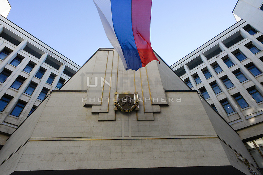 """After 2 hours since the signing of the Russian-Crimean treaty the letters on the entrance of the Crimean parliament """"Parliament of autonomous republic of Crimea"""" are being removed and coat-of-arms is being replaced."""