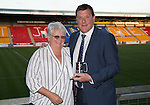 St Johnstone Player of the Year Awards 2014-15.....16.05.15<br /> Betty Young presents the Muirton Sweeties Cult Hero Award to Tommy Wright<br /> Picture by Graeme Hart.<br /> Copyright Perthshire Picture Agency<br /> Tel: 01738 623350  Mobile: 07990 594431