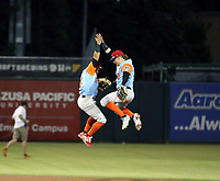 Joncarlos Cintron (left) and Mark Karaviotis (right) celebrate after the completion of the 2019 California League All-Star Game at San Manuel Stadium on June 18, 2019 in San Bernardino, California. The North team won the game, 7-1, and Karaviotis was named Most Valuable Player Bill Mitchell)