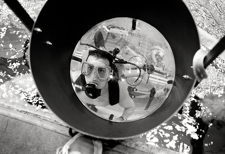 Image copyright John Angerson. <br /> STS-72 mission training.<br /> Dive crew member from Neutral Buoyancy Laboratory (NBL) seen through a large magnifier that was used to observe Astronauts while they undertook neutral-buoyancy diving training,12-meters below the surface of the pool. <br /> Neutral Buoyancy Laboratory (NBL). Johnson Space Center in Houston, Texas.