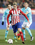 Atletico de Madrid's Fernando Torres (c) and PSV Eindhoven's Andres Guardado (l) and Hector Moreno during UEFA Champions League match. March 15,2016. (ALTERPHOTOS/Acero)