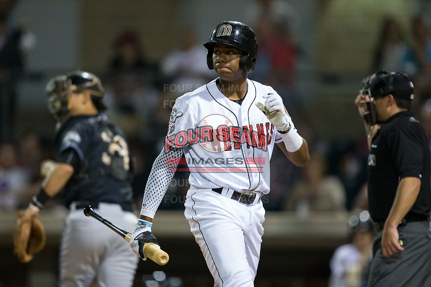 Hunter Greene (49) of the Billings Mustangs walks back to the dugout during the game against the Missoula Osprey at Dehler Park on August 21, 2017 in Billings, Montana.  The Osprey defeated the Mustangs 10-4.  (Brian Westerholt/Four Seam Images)