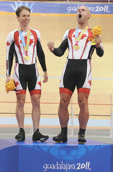 Daniel Chalifour and Ed Veal, Guadalajara 2011 - Para Cycling // Paracyclisme.<br /> Daniel Chalifour and his pilot Ed Veal during the medal ceremony after winning gold in the men's Pursuit // Daniel Chalifour et son pilote Ed Veal participent à la poursuite individuelle. 11/15/2011.