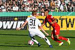 10.08.2019, Donaustadion, Ulm, GER, DFB Pokal, SSV Ulm 1846 Fussball vs 1. FC Heidenheim, <br /> DFL REGULATIONS PROHIBIT ANY USE OF PHOTOGRAPHS AS IMAGE SEQUENCES AND/OR QUASI-VIDEO, <br /> im Bild Nico Gutjahr (Ulm, #31), Kevin Sessa (Heidenheim, #16)<br /> <br /> Foto © nordphoto / Hafner