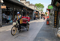 Yangzhou, Jiangsu, China.  Pedicab in Dong Guan Street.