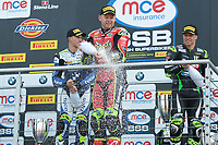 Winner Shane Byrne of Be Wiser Ducati Racing Team sprays the champagne on the podium with second place Christian Iddon of Tyco BMW Motorrad (Left) and third place James Ellison of McAMS Yamaha (Right) after race two of the MCE British Superbikes in Association with Pirelli round 12 2017 - BRANDS HATCH (GP) at Brands Hatch, Longfield, England on 15 October 2017. Photo by Alan  Stanford / PRiME Media Images.