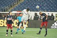FOXBOROUGH, MA - NOVEMBER 1: Andrew Farrell #2 of New England Revolution heads a high ball during a game between D.C. United and New England Revolution at Gillette Stadium on November 1, 2020 in Foxborough, Massachusetts.
