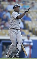 Juan Uribe of the Colorado Rockies bats during a 2002 MLB season game against the Los Angeles Dodgers at Dodger Stadium, in Los Angeles, California. (Larry Goren/Four Seam Images)