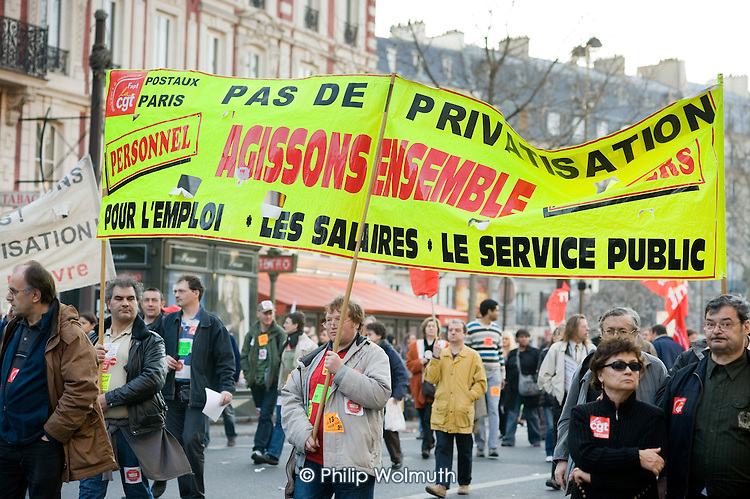 Postal workers march in Paris, joining up to 3 million people across France during a national strike against the Sarkozy government's economic policies.
