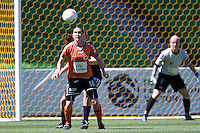 MELBOURNE, AUSTRALIA - DECEMBER 4: Lana HARCH of the Roar watches the ball in round 5 of the Westfield W-league match between Melbourne Victory and Brisbane Roar on 4 December 2010 at AAMI Park in Melbourne, Australia. (Photo Sydney Low / asteriskimages.com)