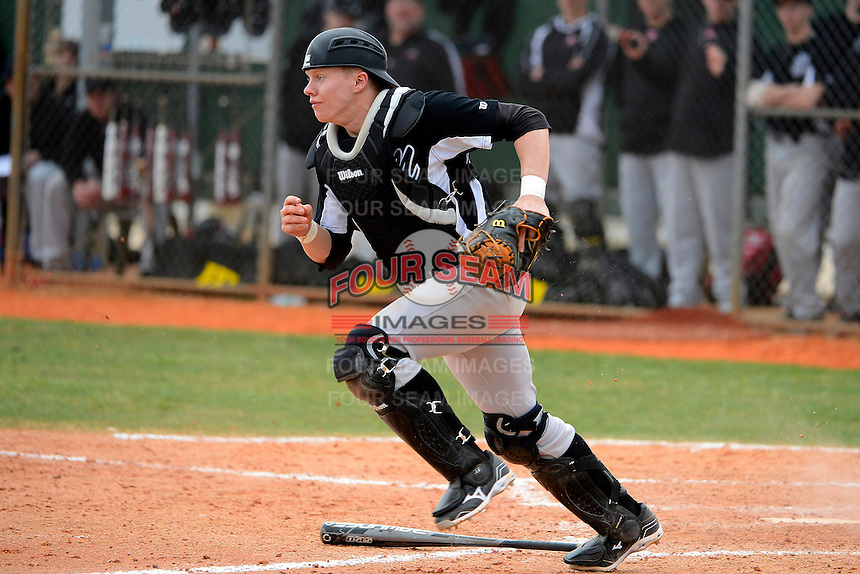 Muskingum Fighting Muskies catcher Matt Connor #7 during a game against the Chicago State University Cougars at South County Regional Park on March 3, 2013 in Punta Gorda, Florida.  (Mike Janes/Four Seam Images)