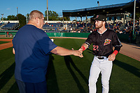 Batavia Muckdogs J.D. Orr (22) shakes hands with Booster Club President Hal Mitchell during a pre-game awards ceremony before a NY-Penn League game against the Auburn Doubledays on August 31, 2019 at Dwyer Stadium in Batavia, New York.  Auburn defeated Batavia 12-5.  (Mike Janes/Four Seam Images)