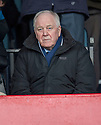 Craig Brown who was a guest of the club at Dundee's Ladies Day  takes his seat in the stand.