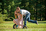 Young couple riding tricycle