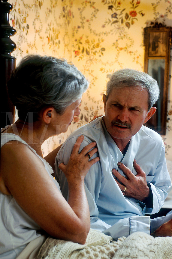 Man's hand grabbing at chest as if suffering from chest pains or heart attack.Man's hand grabbing at chest as if suffering from chest pains or heart attack.
