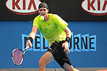 January 22, 2010T\.John Isner of the USA, in action, defeating Gael Monfils, of France 6-1, 4-6, 7-6, 7-6 in the third round of The Australian Open, Melbourne Park, Melbourne, Australia.