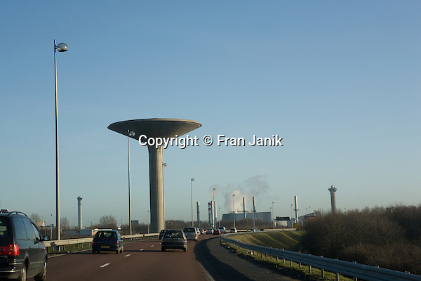 A water tower rises toward the sky on the approach to De Gaulle airport in Paris France