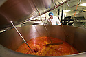 """19/06/16<br /> <br /> Pasquale Tanzarella , Director,  oversees mixing of vat of Tasty Orange ice lolly mix.<br /> <br /> """"The last couple of days have sent the factory into meltdown,"""" exclaimed Pasquale Tanzarella, director of one of the UK's largest independent ice-lolly manufacturers.<br /> <br /> In fact, today alone, his factory will make more than 200,000 ice lollies, which will be sold up and down the country through traditional ice-cream vans and shops. <br /> <br /> Demand has been so high because of the recent hot spell that the cold rooms at Franco's ices, in Kempston, Bedfordshire, are already full to bursting, with more than 40 different varieties of ice-cream and ice-lollies, and today's production of Tasty Orange lollies will probably be on sale by late afternoon.<br /> <br /> The lollies start life in a huge 2,000-litre vat, as a syrupy, bright orange liquid, before being poured into the traditional ice-lolly moulds.<br /> <br /> From there they are passed over a fast-freezer, at around -36C, to super cool the liquid into ice, which only takes around 20 minutes, before being loaded into their colourful outer wrapper.<br /> <br /> And then it's straight into wholesale boxes, stored in the factory's cold rooms, and sold the very same day.<br /> <br /> It's a super success story for this family-run business, which was founded in1964 by Pasquale's father, Domenico Tanzarella, originally to sell ice-creams through a local chain of vans.<br /> <br /> """"In the 70s we used to only supply vans within about a 60-mile radius of the factory,"""" said Pasquale.<br /> <br /> """"But we've grown steadily over the years and now we export to Cyprus, Ireland and even South Africa, as well as being one of the biggest suppliers here in the UK.<br /> <br /> """"Our best seller by far is the Mr Bubble ice-lolly,"""" said Pasquale. """"We were the very first company to launch a bubble gum flavoured lolly and it's been our best seller ever since.""""<br /> <br /> Last year they sold more than"""
