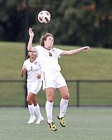 Harvard University midfielder Haley Washburn (6) heads the ball. In overtime, Harvard University defeated Yale University,1-0, at Soldiers Field Soccer Stadium, on September 29, 2012.