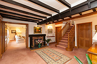 BNPS.co.uk (01202 558833)<br /> Pic: Savills/BNPS<br /> <br /> Pictured: The entrance hall with the wooden staircase and visible wooden beams in the ceiling.<br /> <br /> A historic thatched home where Cromwell's army stayed during the English Civil War is on the market for £1.6m.<br /> <br /> The Barracks, so-named for its links with Cromwell more than 370 years ago, has spectacular country views and is in one of Cheshire's most popular areas.<br /> <br /> The five-bedroom property just outside the picturesque village of Bunbury is a far cry from how it would have looked in Cromwell's time, having been extended over the years.<br /> <br /> It was used in the 17th century by Cromwell's armies during the siege of Beeston Castle - two miles away. The castle's location made it valuable to both the royalists and parliamentarians.