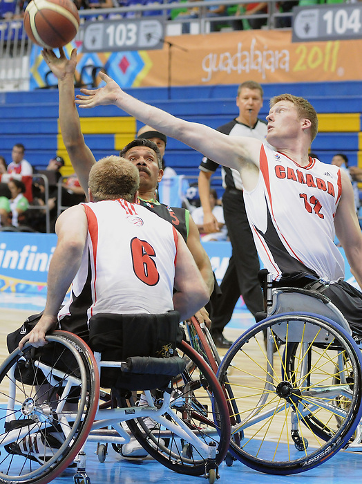Bo Hedges and Partrick Anderson, Guadalajara 2011 - Wheelchair Basketball // Basketball en fauteuil roulant.<br /> Team Canada competes in the bronze medal game // Équipe Canada participe au match pour la médaille de bronze. 11/18/2011.
