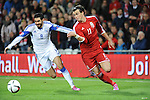 UEFA European Championship at Cardiff City Stadium - Wales v Cyprus : <br /> Gareth Bale of Wales battles for the ball with Charis Kyriakou of Cyprus.